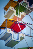Old Ferris wheel. With empty colorful cabins Royalty Free Stock Photos