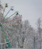 Ferris wheel in retro vintage style. Snowy winter day stock images