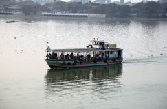 Old ferry boat crosses the Hooghly River in Kolkata Royalty Free Stock Photo