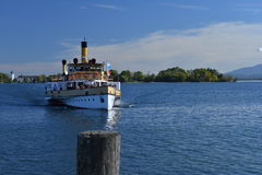 Old ferry crossing the Chiemsee lake, Bavaria, Germany Royalty Free Stock Photo