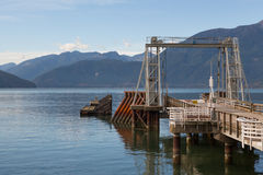 An old ferry dock and distant hills, Porteau Cove Park, BC Stock Photos