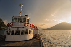 The old ferry at Lake Como during the golden hour, Lake Como Royalty Free Stock Photography