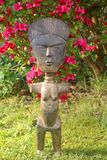 African fertility statue in a Japanese garden Stock Photos