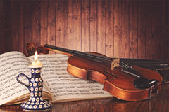 Old fiddle and music score Royalty Free Stock Photo