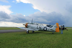 Old fighter american plane on green field side view Royalty Free Stock Photography
