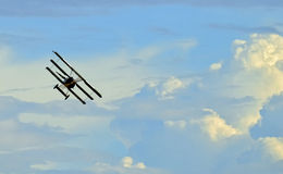 Old fighter plane flying on sky Stock Images