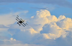 Old fighter plane flying on sky Stock Photography