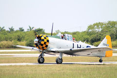 Old fighter plane landing Royalty Free Stock Photo