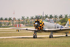 Old fighter plane landing Stock Photography