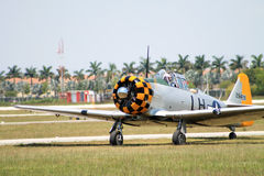 Old fighter plane landing Royalty Free Stock Photography
