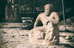 Old figure of man, carved stone Stock Photography