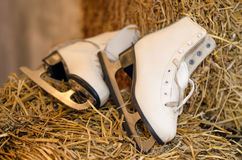Old figure skates and Christmas garland lights on old dark woode Stock Photos