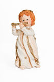 Flute Playing Angel Figurine. Old Figurine Isolated - Flute Playing Angel Stock Images