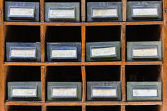 Old file cabinet. Detail of metal drawers with handwritten tags Royalty Free Stock Photography