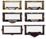 Old File Drawer Frames With Blank Labels. Collection of six old, tarnished brass file drawer label holders and drawer pulls with blank cards. Isolated on white Stock Photo