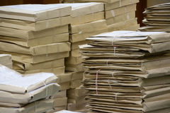 Old files in envelope paper stacking. Up in a messy order Stock Photo