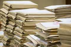 Old files in envelope paper stacking. Up in a messy order Stock Photography