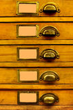 Old Filing Cabinet. Old Wood Drawer Set with Blanked Labels Stock Images