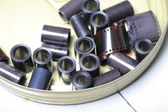 Old film archive negatives in a round metal can. Film archive negatives in a round metal can Royalty Free Stock Images