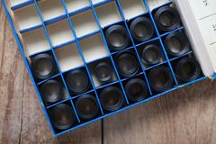 Film archive negatives in a round metal can. Old film archive negatives in a round metal can Stock Photo