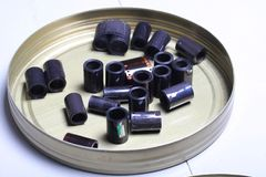 Film archive negatives in a round metal can. Old film archive negatives in a round metal can royalty free stock photo