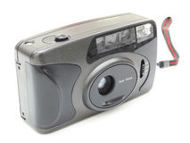 The old film camera. Of gray color on a white background Stock Image