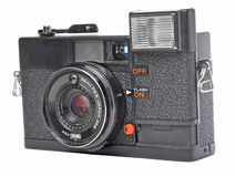 Old film camera. Angled shot of an old film camera isolated on a white background Stock Photography