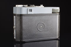 Old film camera back with viewfinder isolated on the black background. Old retro film camera isolated Stock Photography