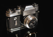 The old film camera on a black background. Stock Photo