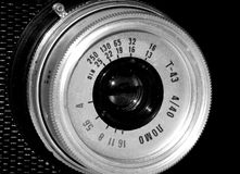 Old film camera on black and white closeup picture Royalty Free Stock Photography
