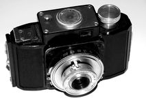 Old film camera on black and white closeup picture Royalty Free Stock Photos