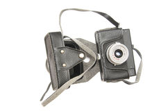 Old film camera in cover isolated. On white background Royalty Free Stock Photo