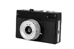 Old film camera in cover isolated. On white background Royalty Free Stock Photos
