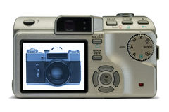 Old film camera on display of modern digital camera. Isolated on white Royalty Free Stock Photography