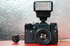 Old film camera and flash Royalty Free Stock Photography