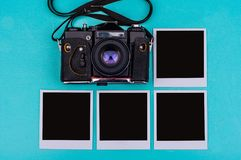 Old film camera and instant photographs with empty space on the cyan background. Travel concept. stock image