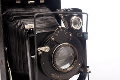 Old film camera isolated on white. Retro vintage film camera on white background Royalty Free Stock Photos