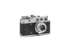 Old film camera isolated on white. Retro vintage film camera on white bag round Stock Photography