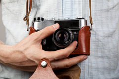 Old film camera in leather case. Retro vintage film camera in leather case Royalty Free Stock Photography