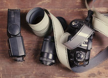 Old film for the camera, a lens, flashlight and the camera Royalty Free Stock Image