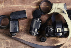 Old film for the camera, a lens, flashlight and the camera Stock Photography