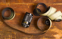 Old film for the camera and a lens Stock Photos