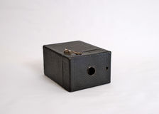 Old Film Camera and manual. An Antique box film camera on an easily removable light grey background Stock Photography