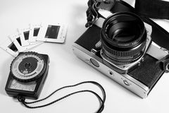 Old film camera, meter and slides Stock Photography