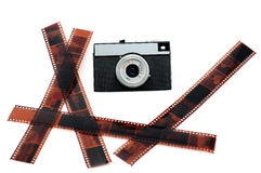 The old film camera and negative film. Stock Photos