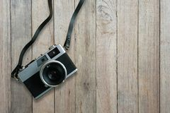 Old film camera on old wooden floor, top view. With copy space royalty free stock images