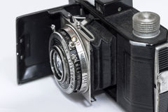 Old film camera in the open state. The product of the early 20th century. Old-fashioned film camera on a white background stock photo