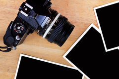 Old film camera and photo paper Royalty Free Stock Photo