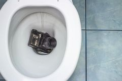 The old film camera recessed in the toilet stock images
