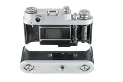 Old film camera with removed back cover. View of the mechanism of pulling film stock photo